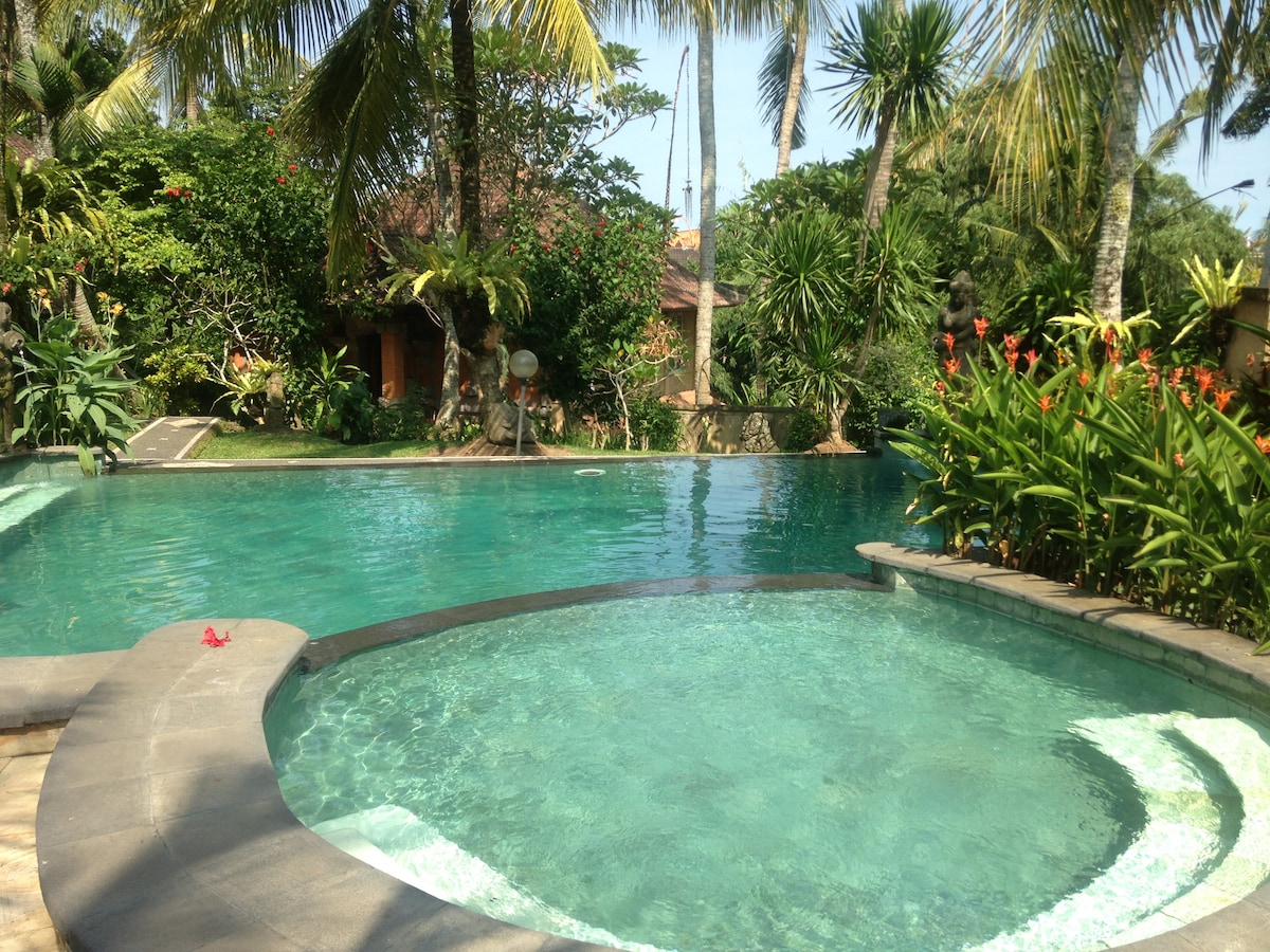 View over the pool to Villa Cinta's first floor.