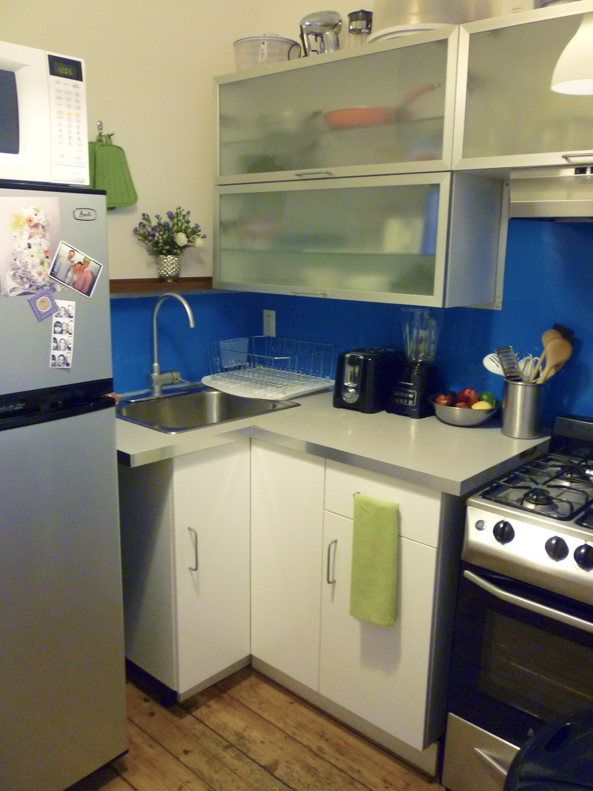 The tidy, functional kitchen which is directly adjacent to the bedroom.