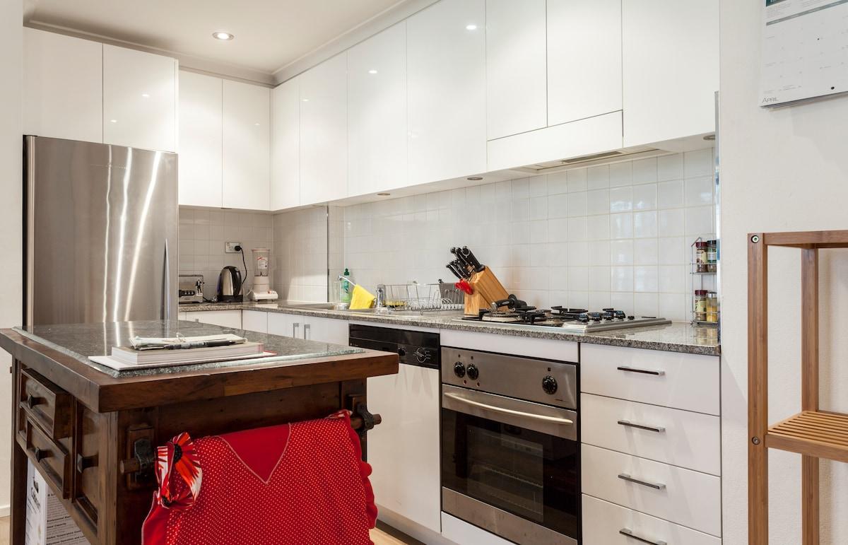 Oven, four burner cook top, dishwasher, kettle, blender, fridge & freezer.