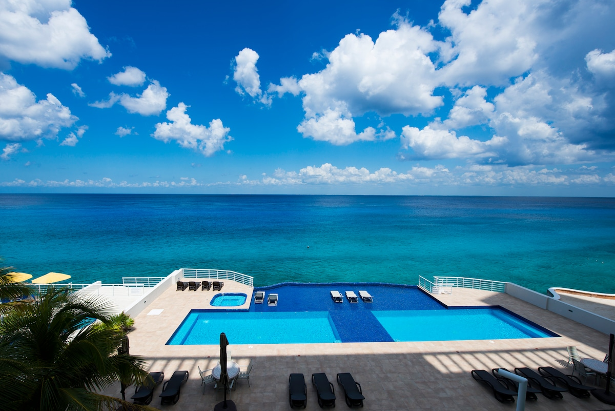 Caribbean view from condo, double pool area, jacuzzi
