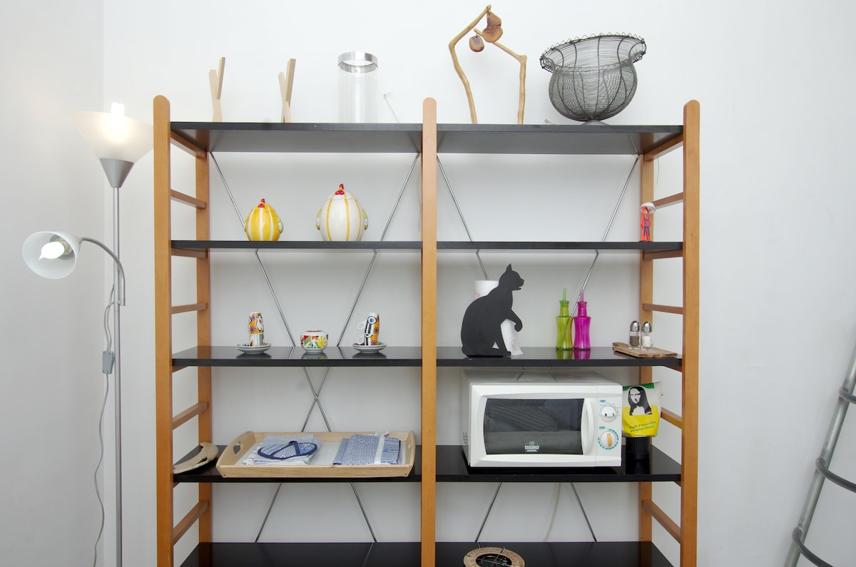 living, bookcase with microwave