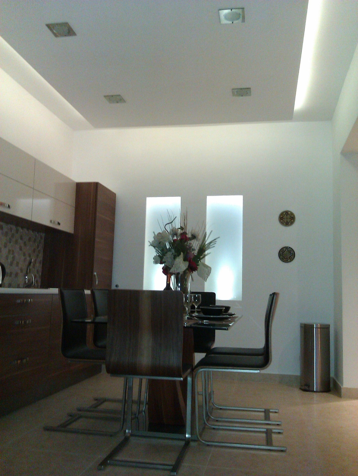 Dining table. Gypsum soffits and light features
