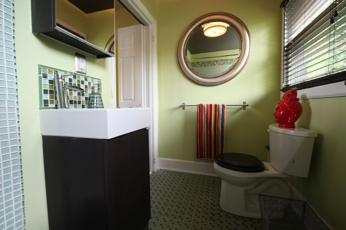 modern sink with new bath and shower tile