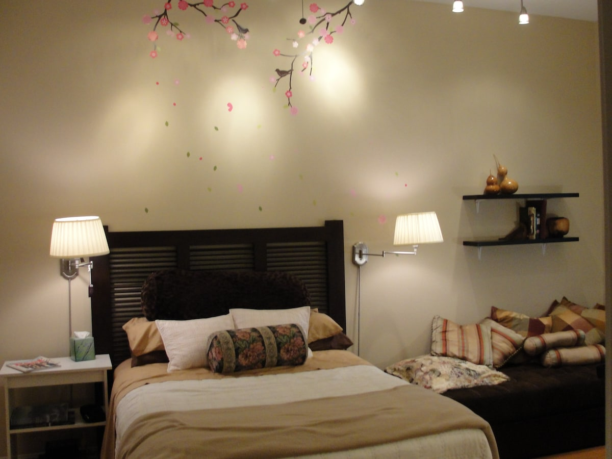 There is custom lighting both at the bed and in the work area.