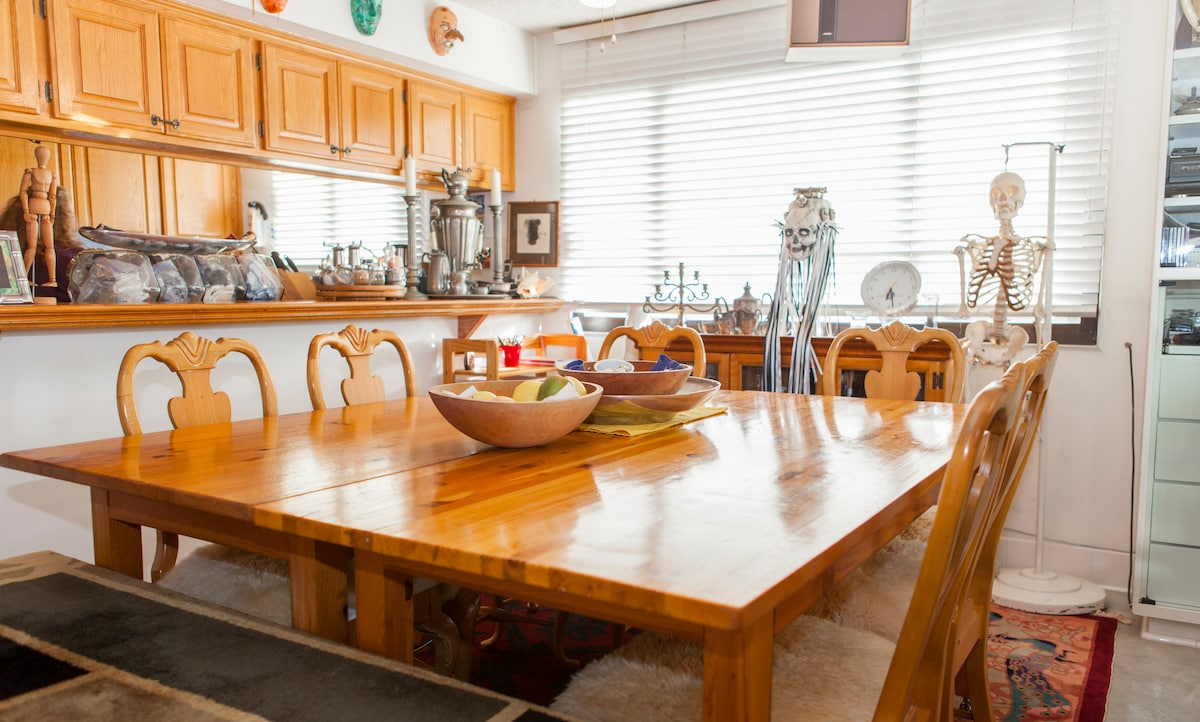 A large dinning table provides a space for hours of conversation and reading.
