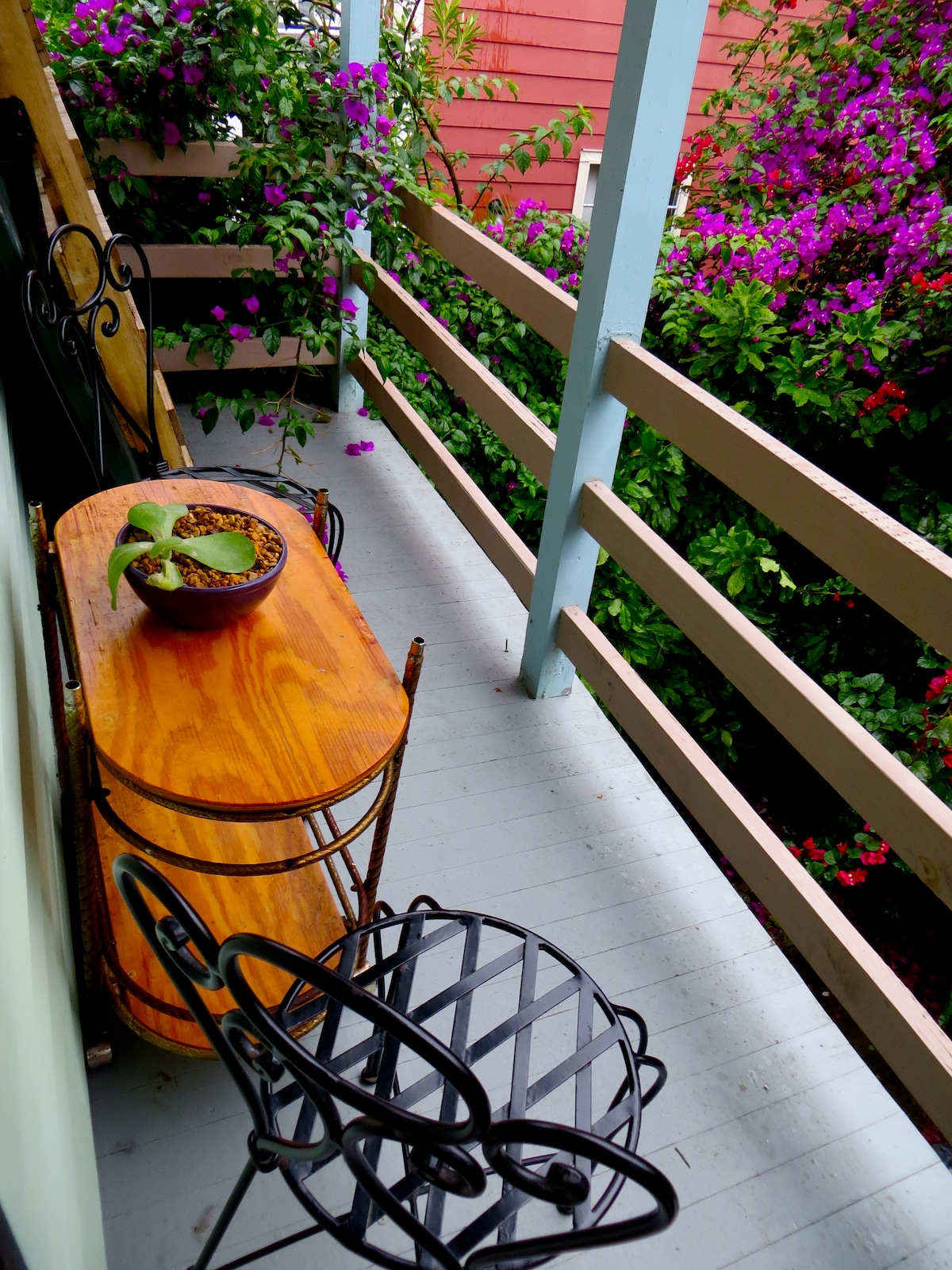 Take your hot tea or coffee to the balcony, located outside by the kitchen.