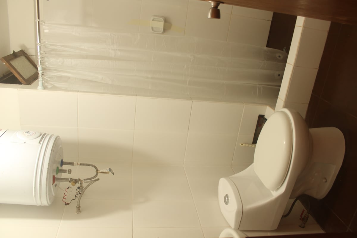 Clean bathroom with shower and hot water.