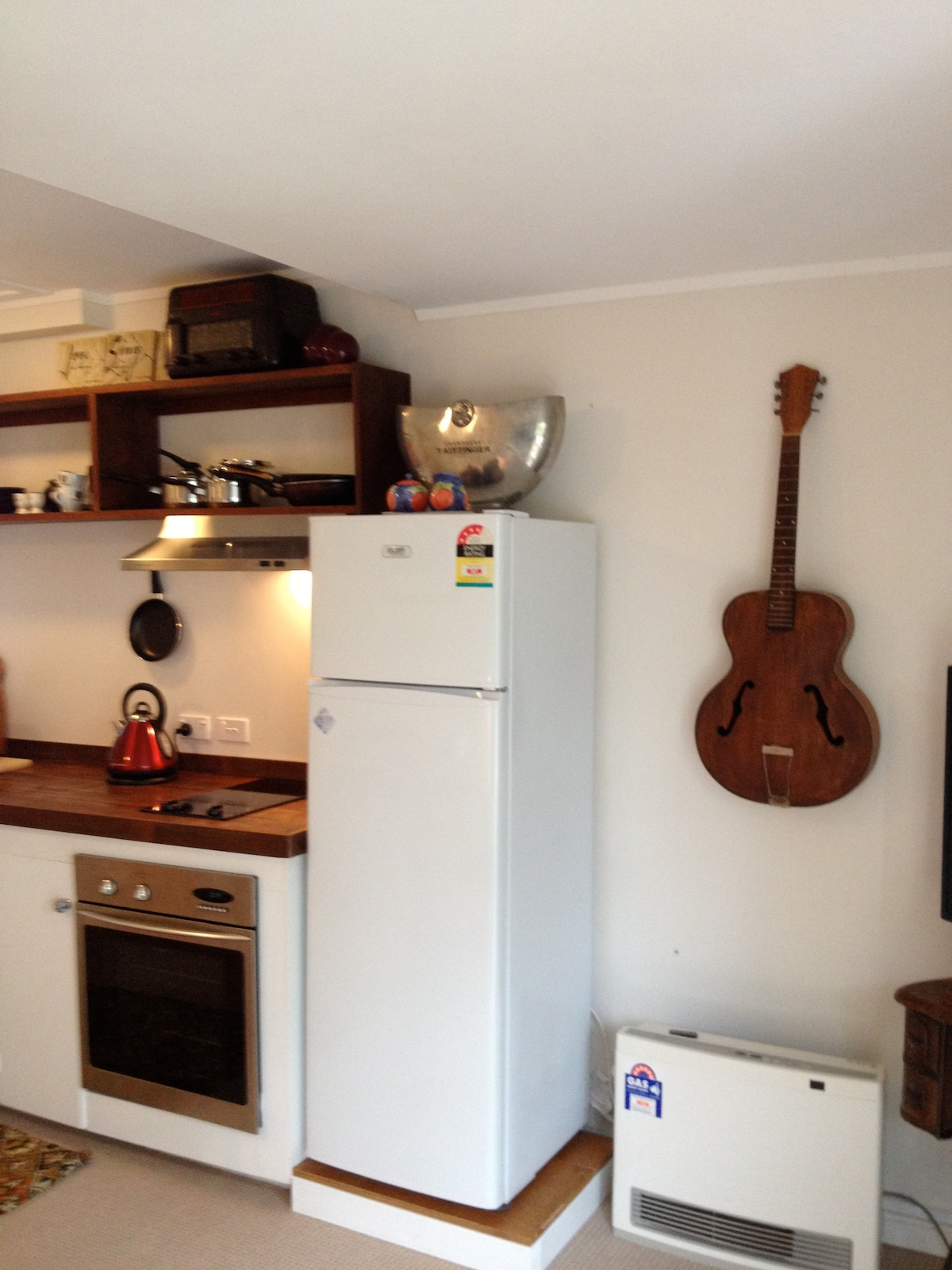 Kitchen showing Gas heating and Fridge.