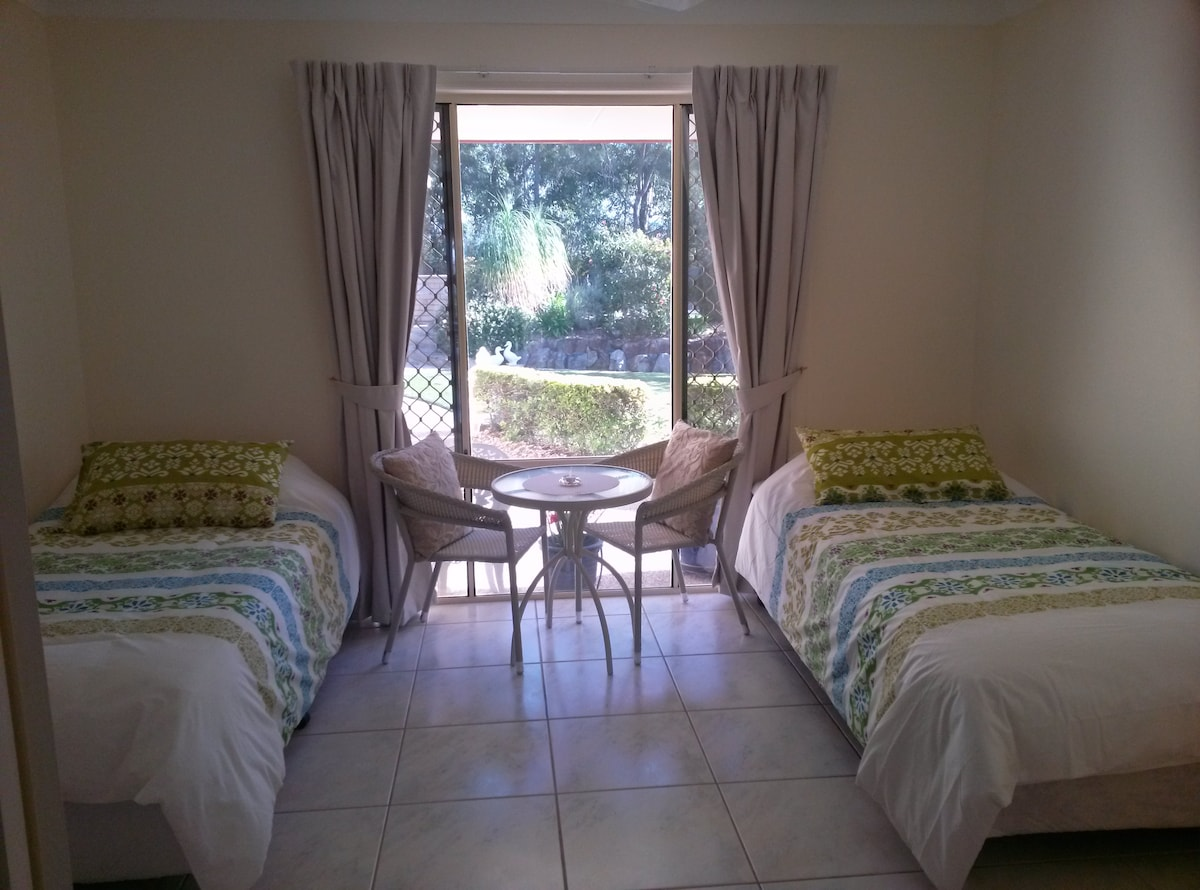 2 single beds in separate sunny room with lovely outlook over garden