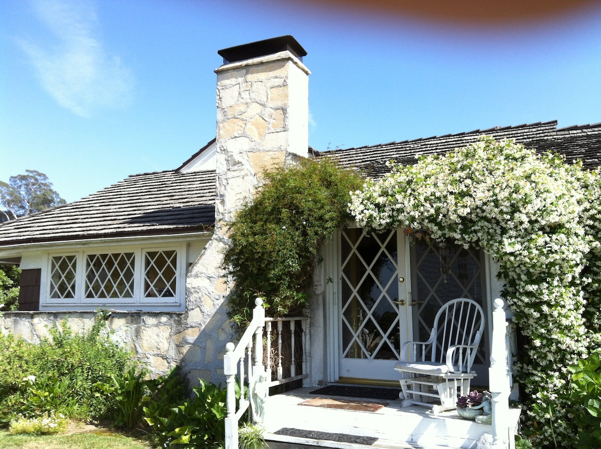 The Hollywood Cottage with white Jasmine blooming over the doors April-July
