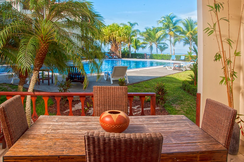 Private dining balcony with pool and ocean views make for magical sunset dinners