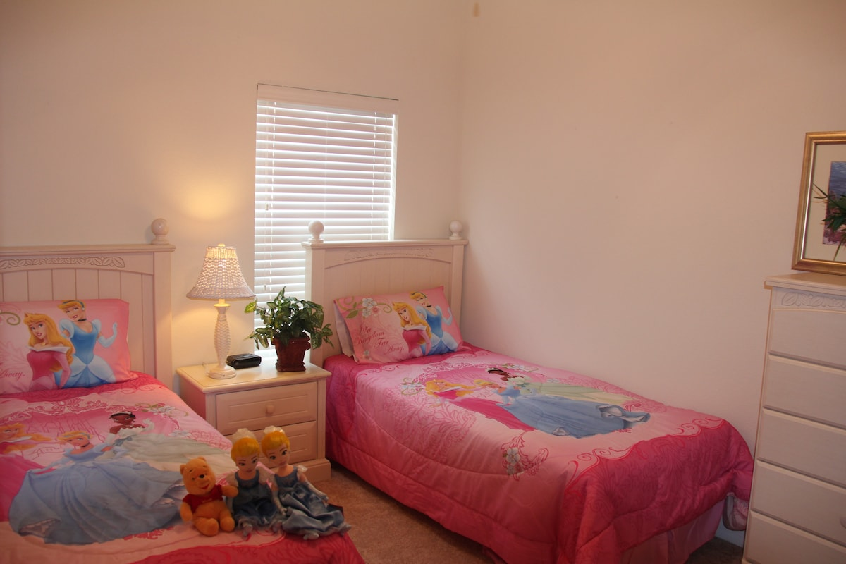 upstair girl's room with two twin beds