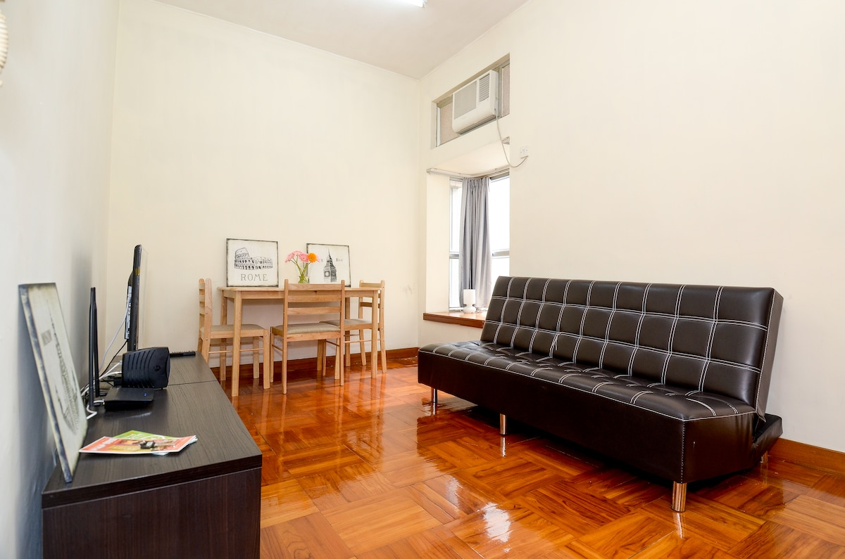 The living room with a sofa bed, wifi, air-conditioner provided