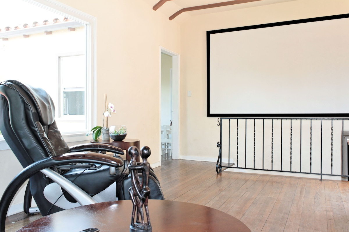 An impressive 10 foot projection screen, powered by a 3D Projector (complete with 4 sets of glasses)