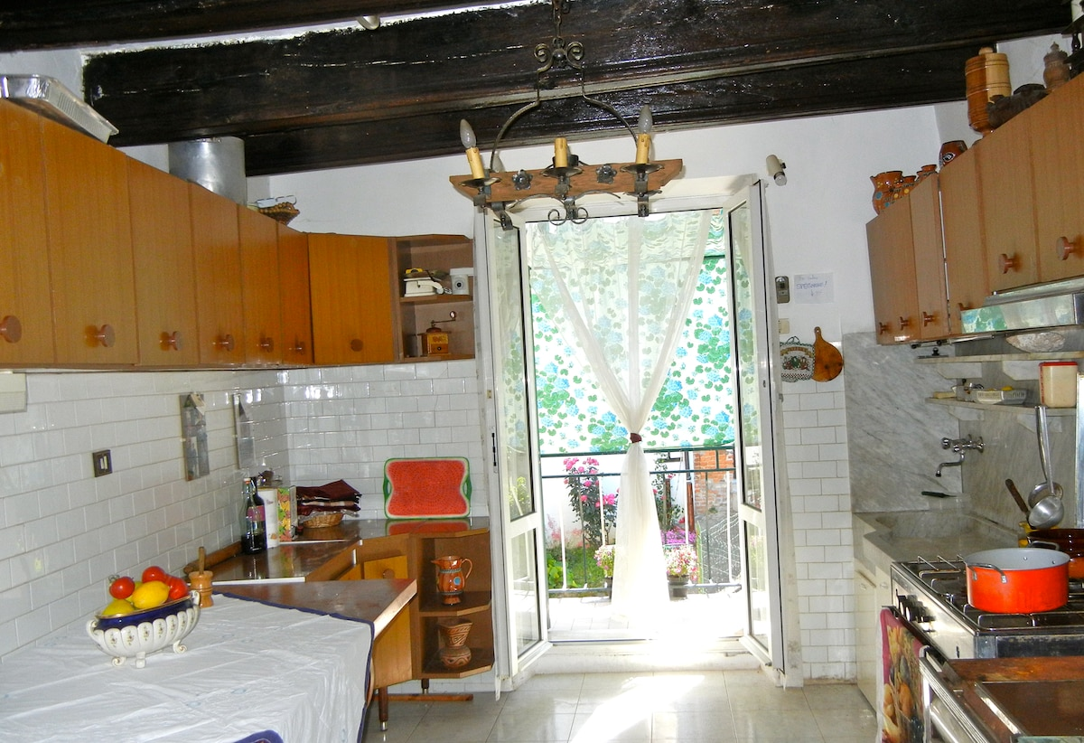 Spacious, well equipped kitchen with marble sink and antique wooden beams