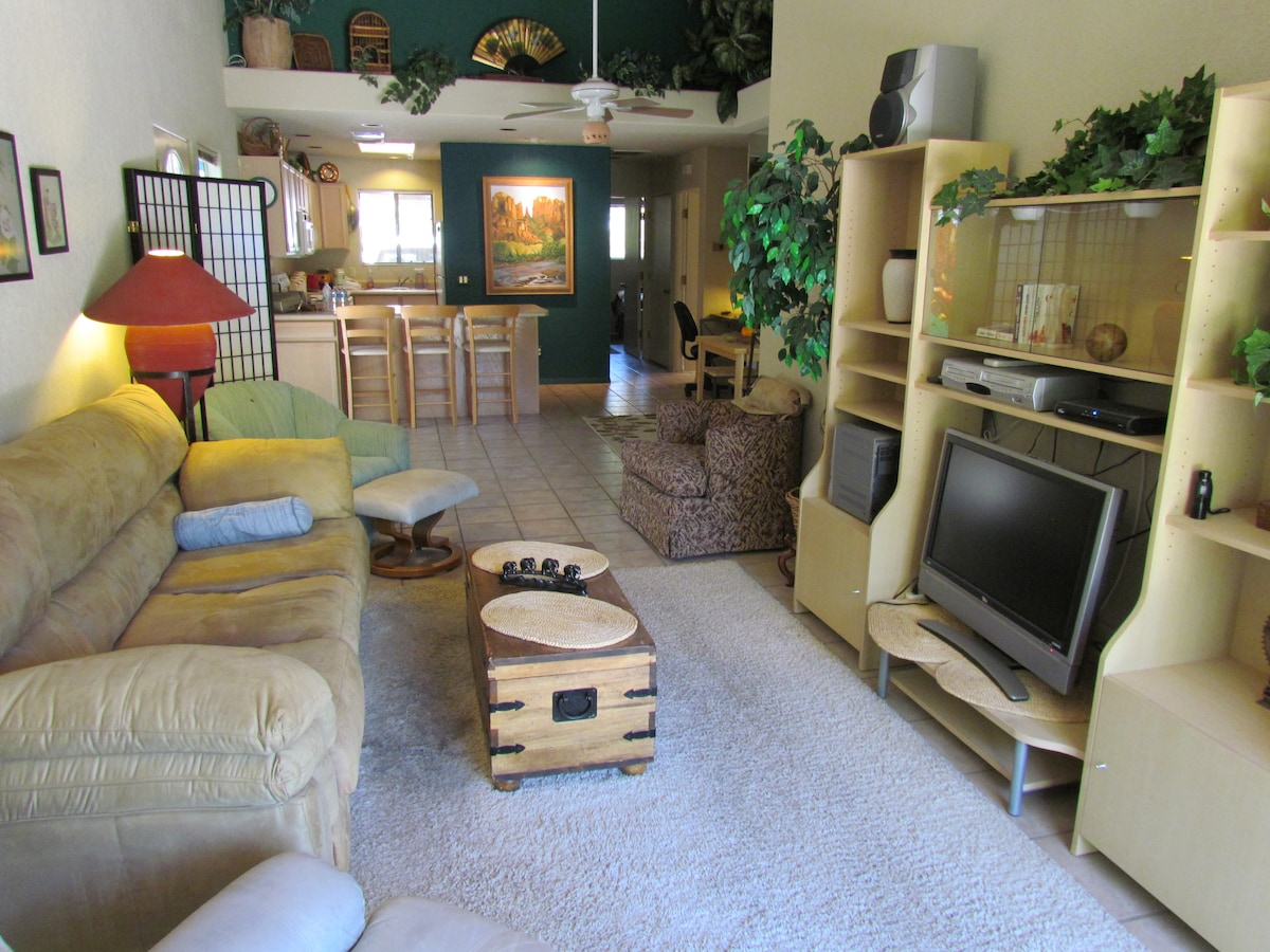Living room and kitchen viewed from patio door -- a comfortable place to retire after your full day enjoying all that Sedona has to offer