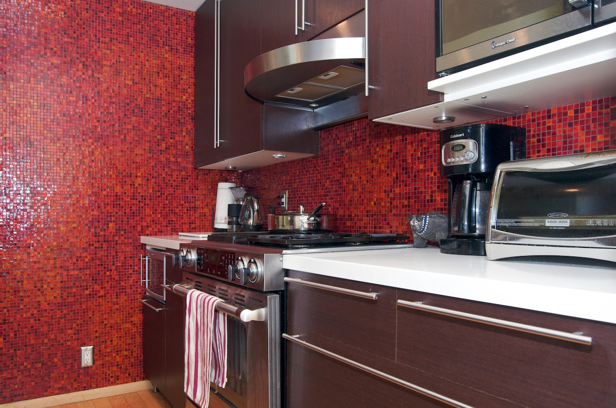 Our modern kitchen features a refrigerator, microwave, coffee maker, toaster oven, and electric tea kettle.