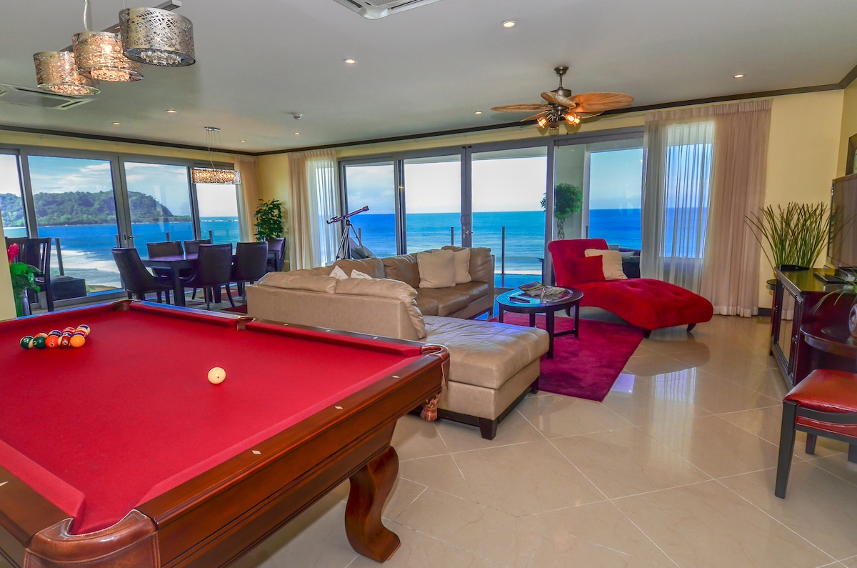 Pool Table, couch, chaise lounge, telescope and dining room