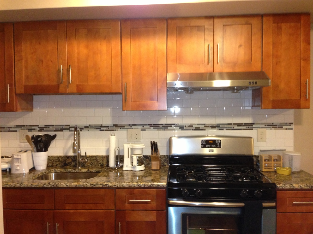 Kitchen is equipped with toaster, coffee maker, cooking and eatting ware