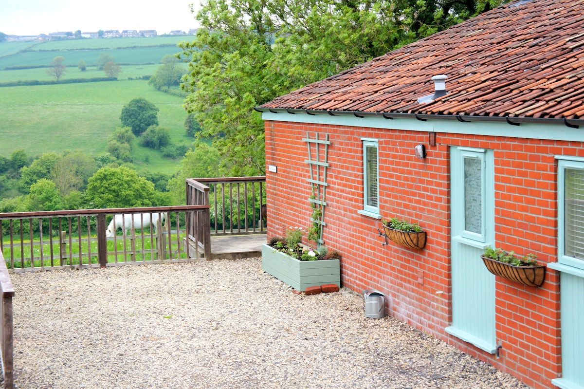 Outstanding views across the Cam Valley with a private deck and small garden and access to 100 miles of footpaths.