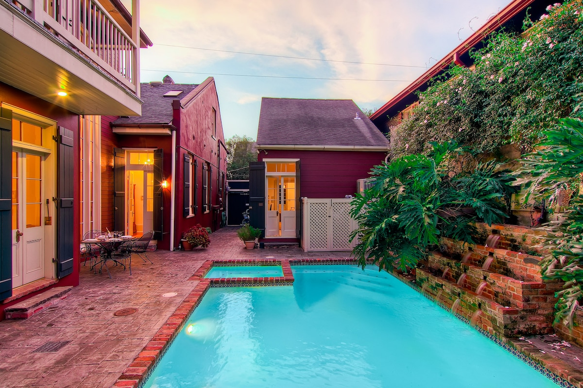 Gated, secure entryway to courtyard with pool and fountain.