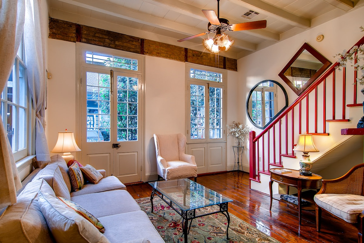 Living room with lots of light and restored historic charm.