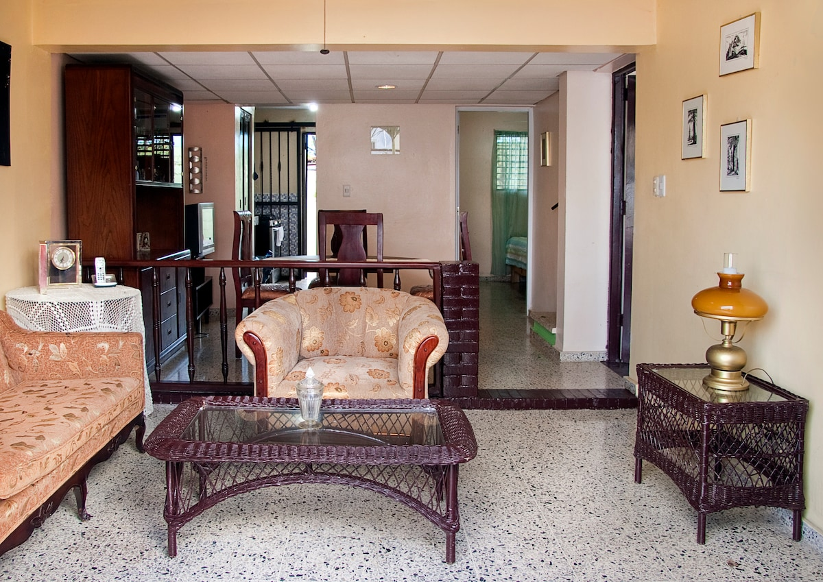 living room, dining room, kitchen on left, small bedroom w bathroom on right