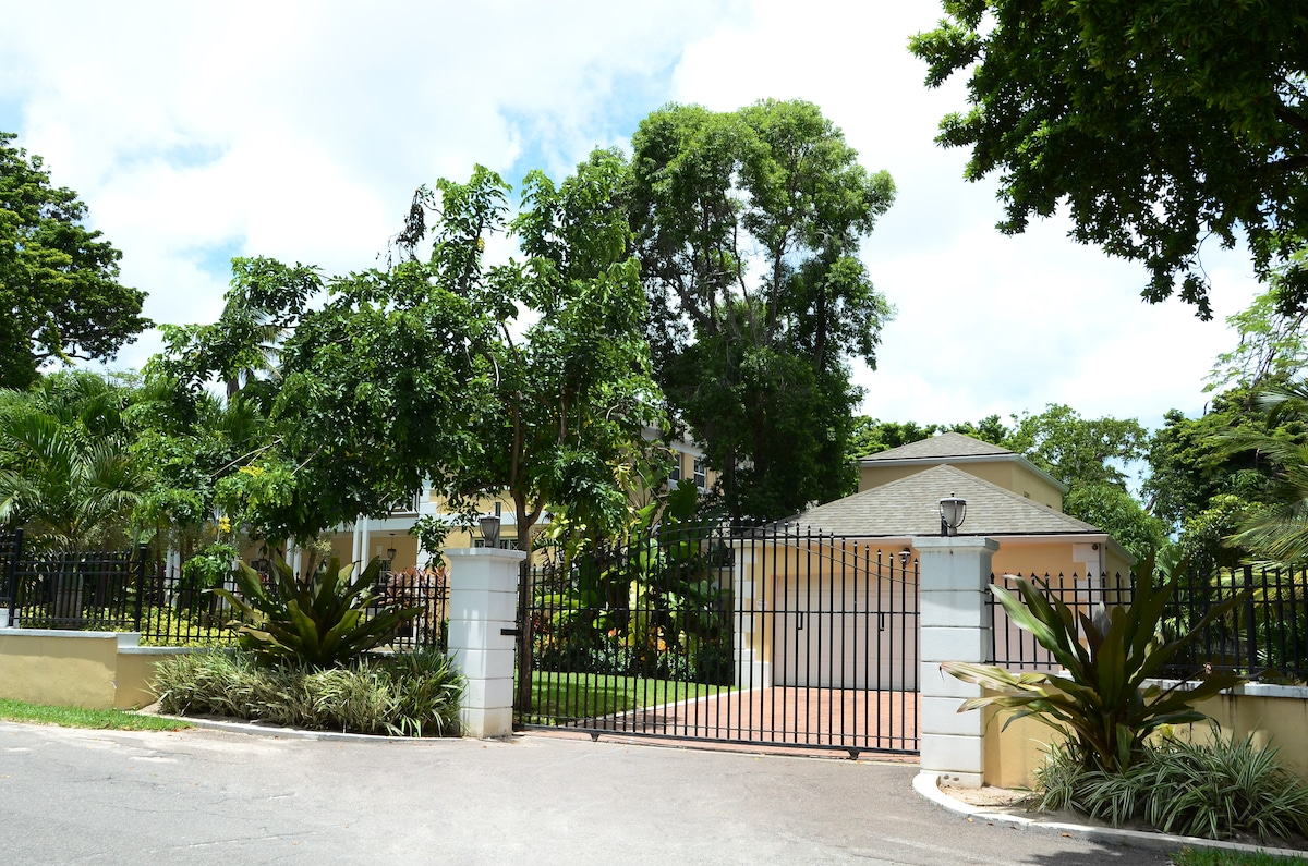 Electric Gate and a two car garage for your comfort and convenience
