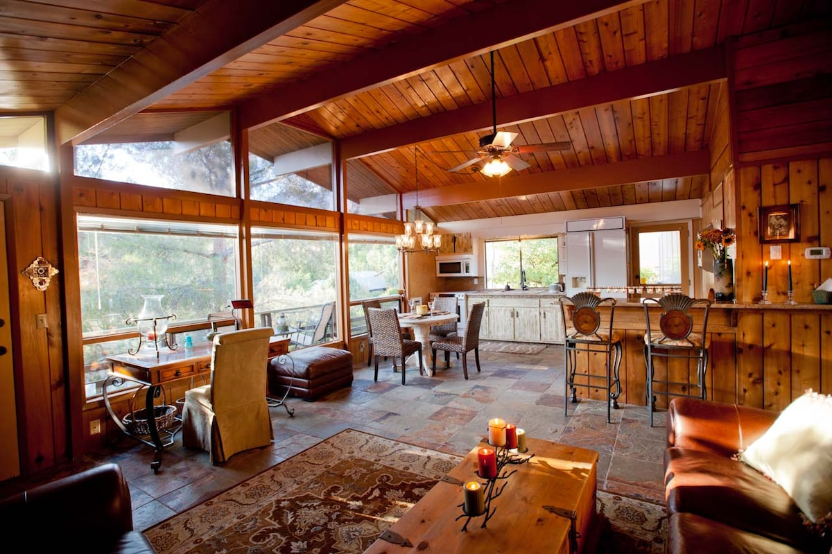 Spacious living area with cedar walls and ceilings