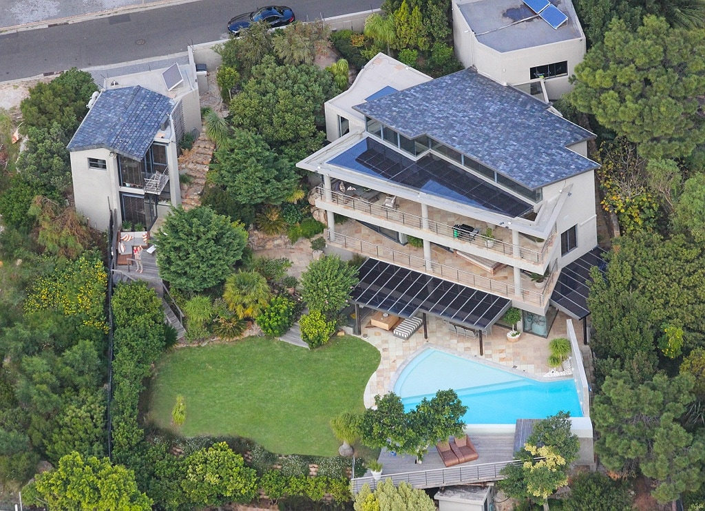 Helicopter view of the main villa to the right and the guest house to the left with its own sun deck! Please note construction next door (to the left) will update once completed.