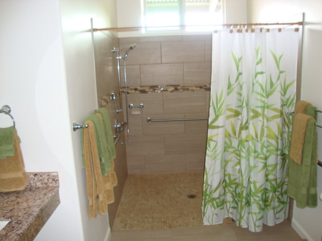 Shared Fully  handicapped accessible shower in large bathroom