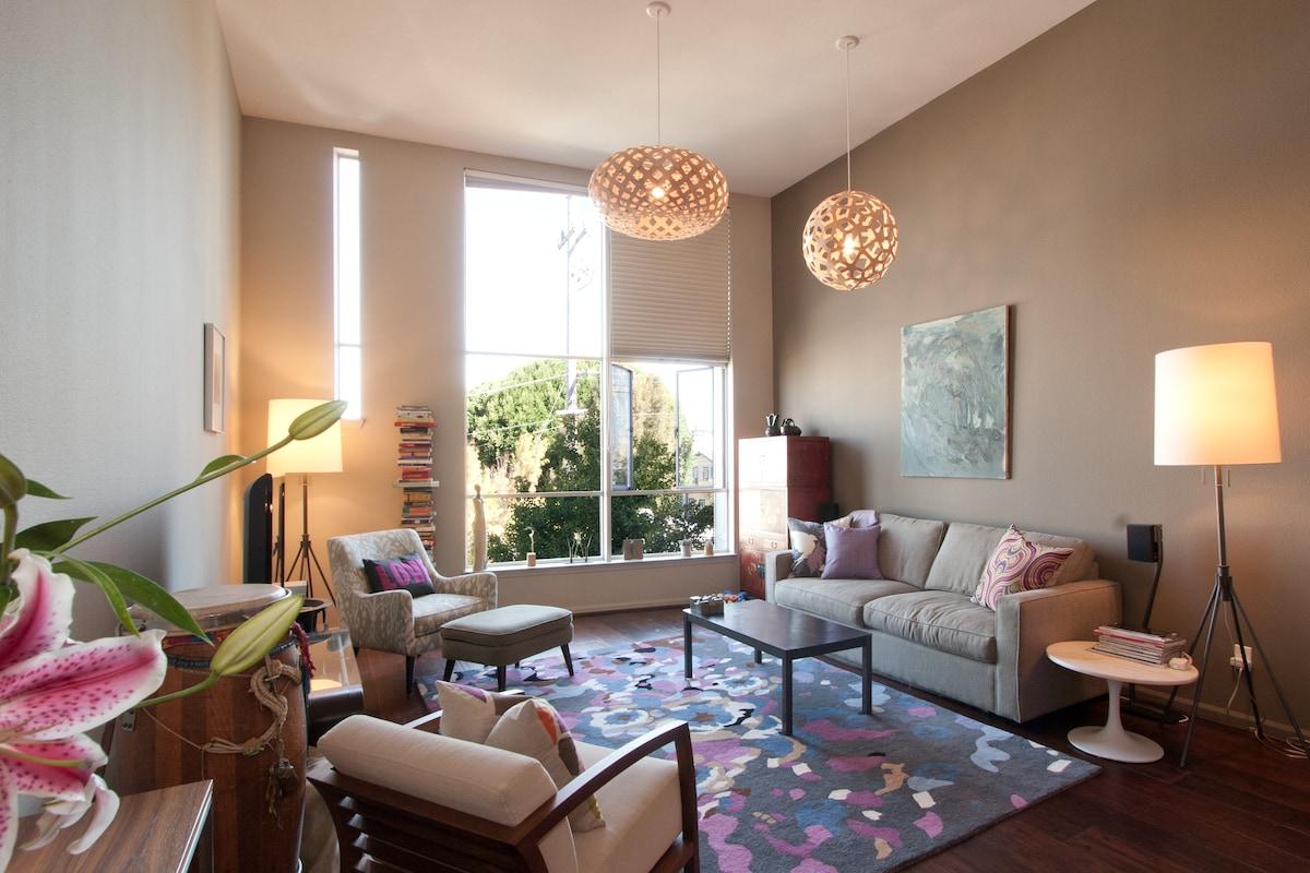 My living room with David Trubridge pendant lights. Love them!