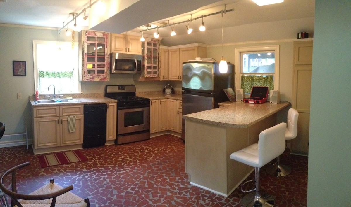 Full service kitchen w bar.  New cabinets blended in with vintage glass cabinets make for functional, eclectic style.