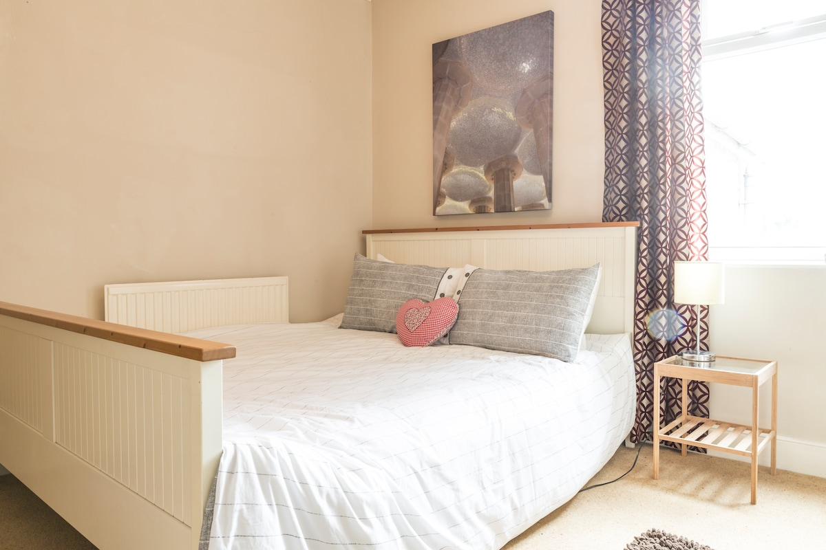 Your light and airy double room with comfy king-size bed