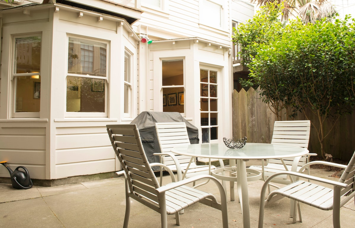 Spacious outdoor patio with patio furniture right off the living room