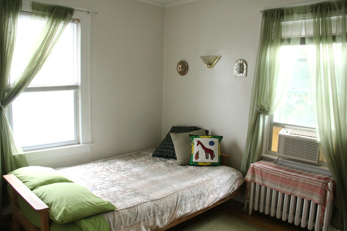 private guest room with queen bed ready (AC unit in window on summer time)