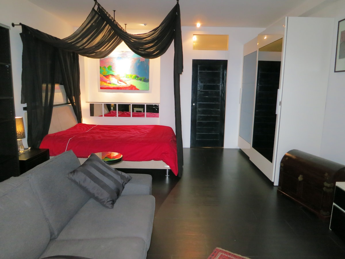 Ready for your sweet dreams - kitchen and sanitary facilities are behind the black door