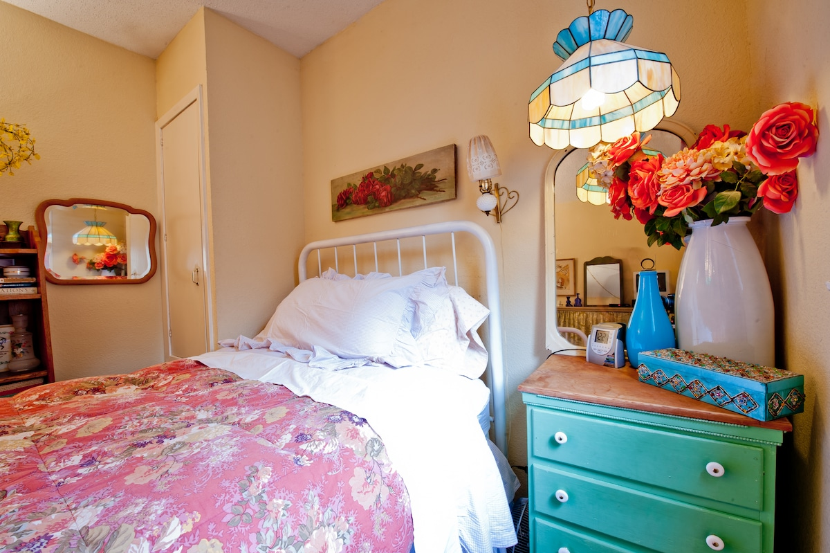 A very comfortable bed in a calming room.  Closet space and drawer space available.