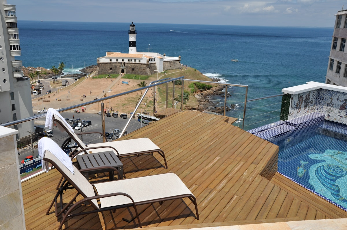 Upper floor deck, view of Farol, private swimming pool with mosaics of orixás