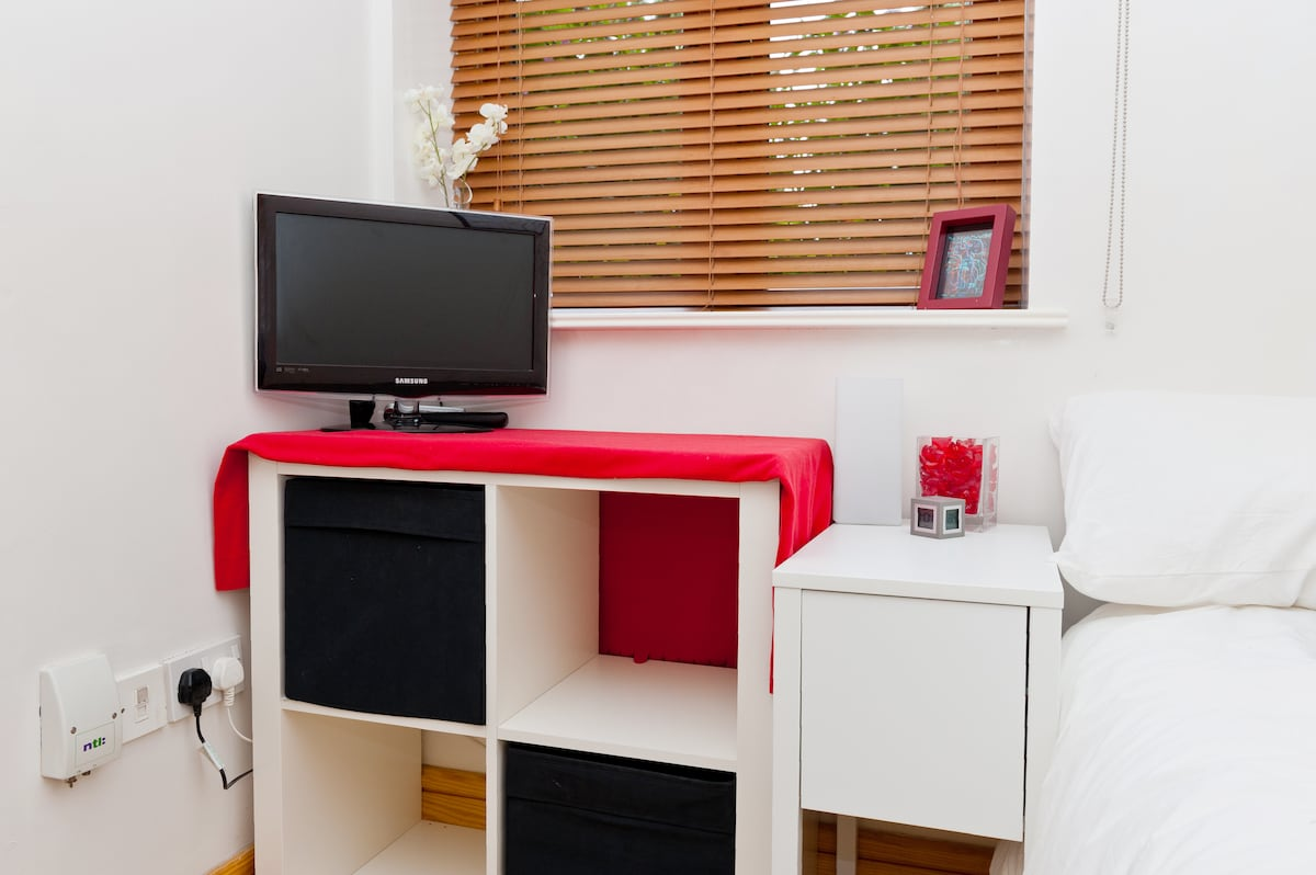 Storage, TV & DVD player and alarm clock in your private bedroom