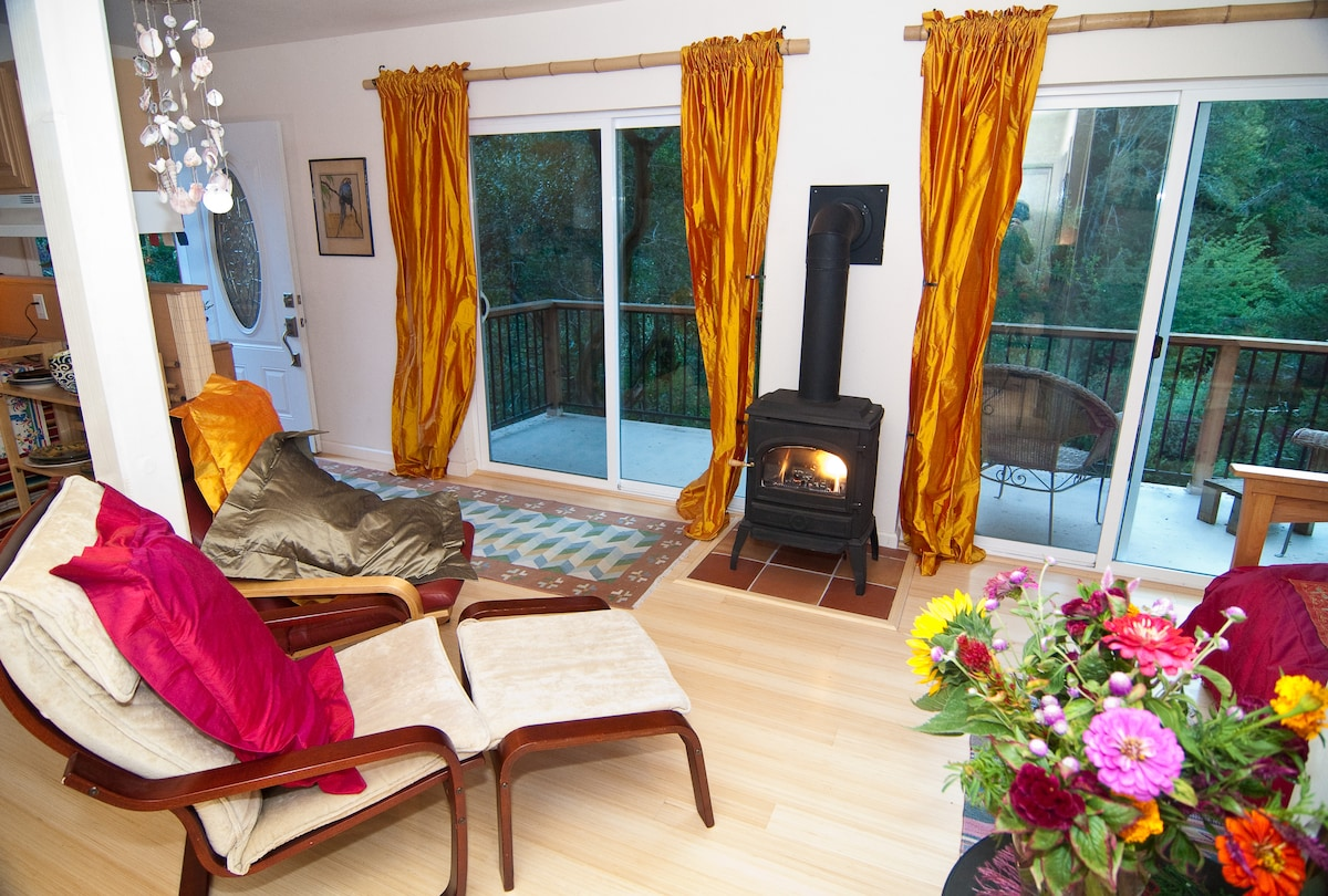 Relax by the Fireplace, Gazing Out the large floor to ceiling double doors at the forest and Mt. Barnabe