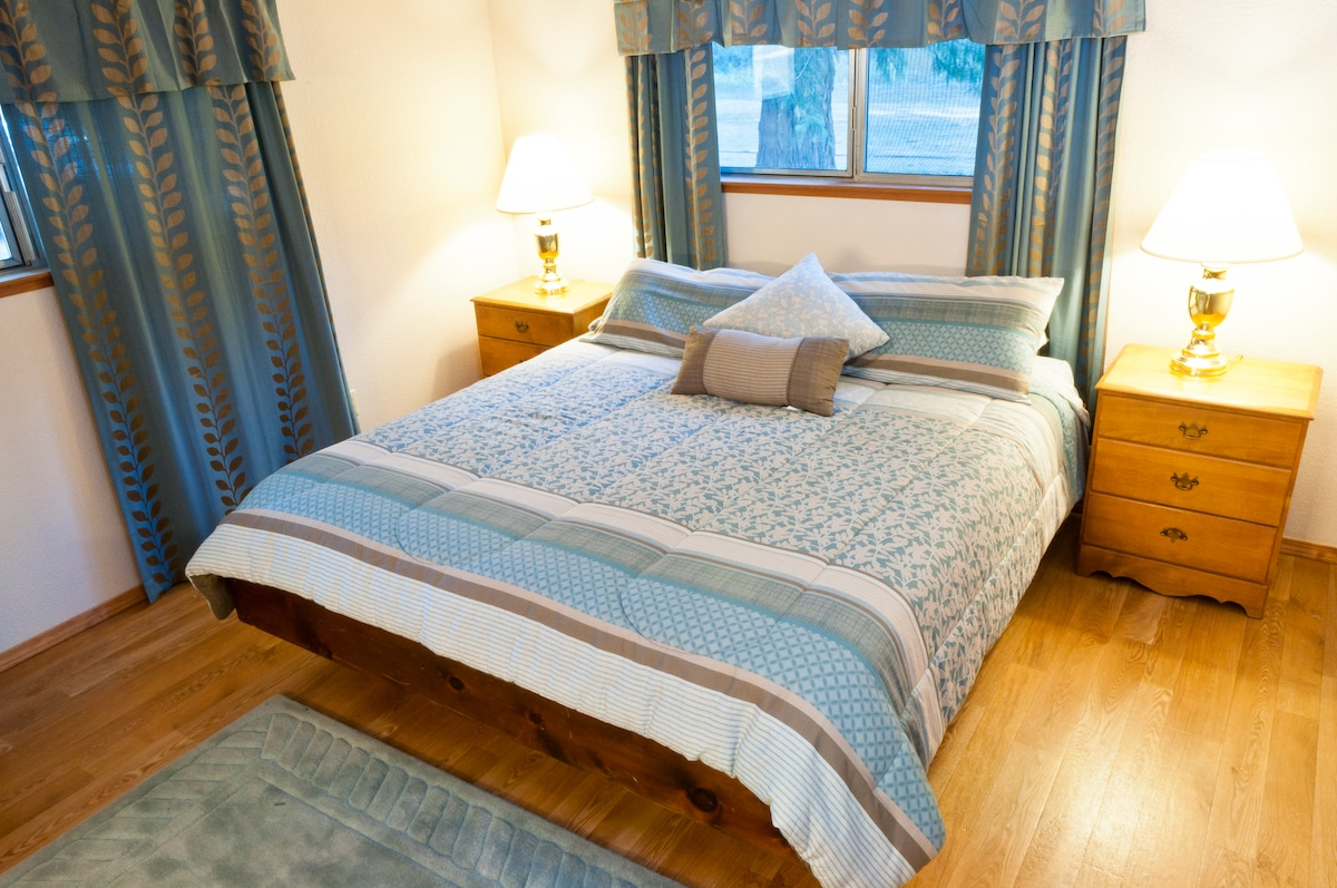 This master bedroom has a king size bed and bathroom attached.