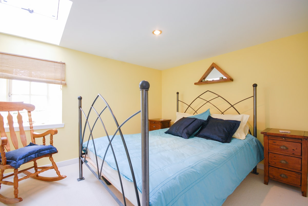 Bright Bedroom, with skylight, large mirrors and built-in wardrobe.