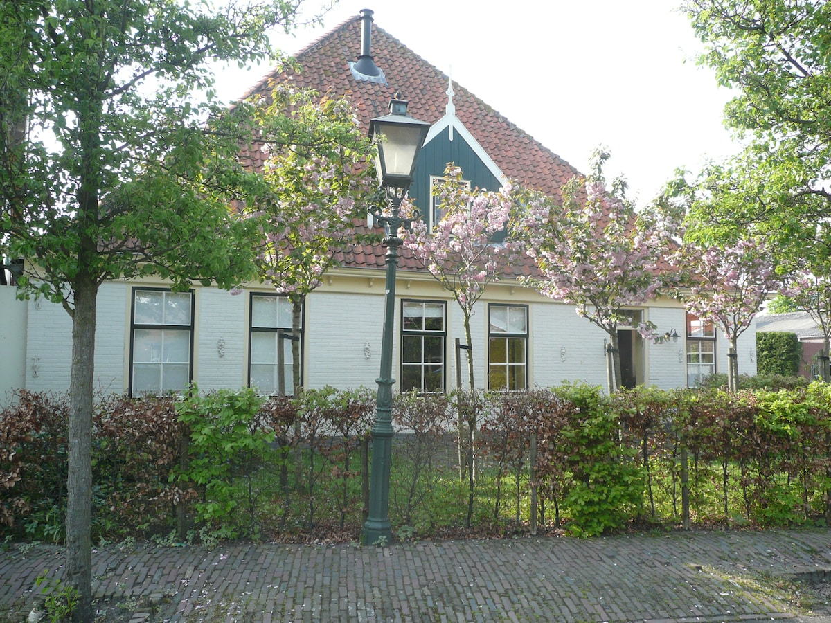 The front of the house in spring, the four rooms from the left are the Farmer's Wedding