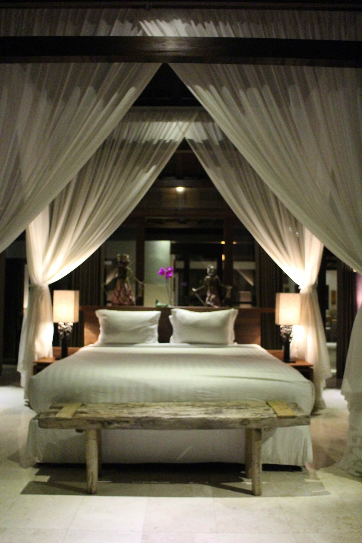 King size bed in master suite -- lay down and look up to see the traditional carving!