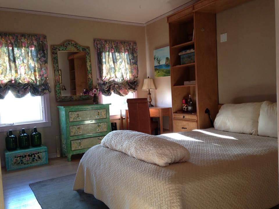 This is a beautiful sunny room that looks West and has wonderfully warm, welcoming light and soft, comfortable linens