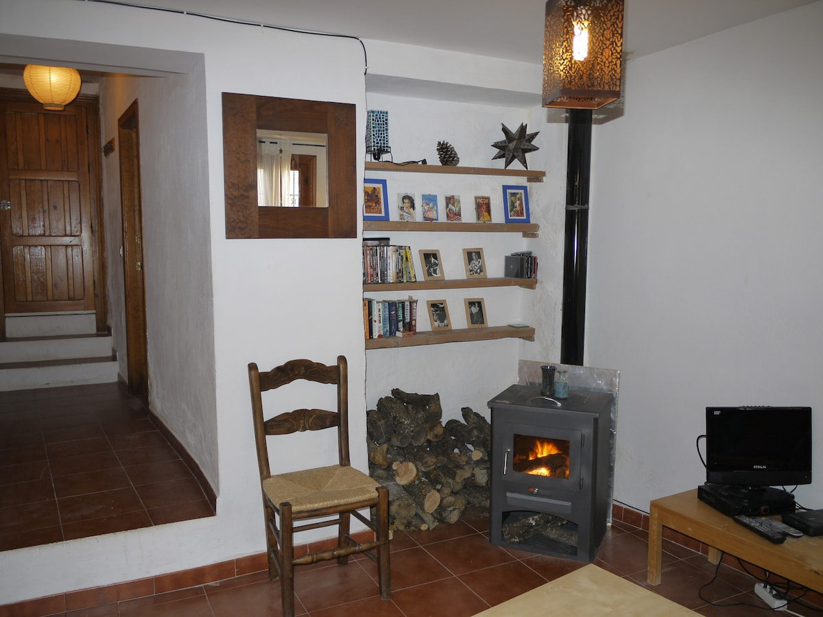 Lounge with DVD´s and Log Burner , with passageway to Kitchen, and Downstairs bathroom.