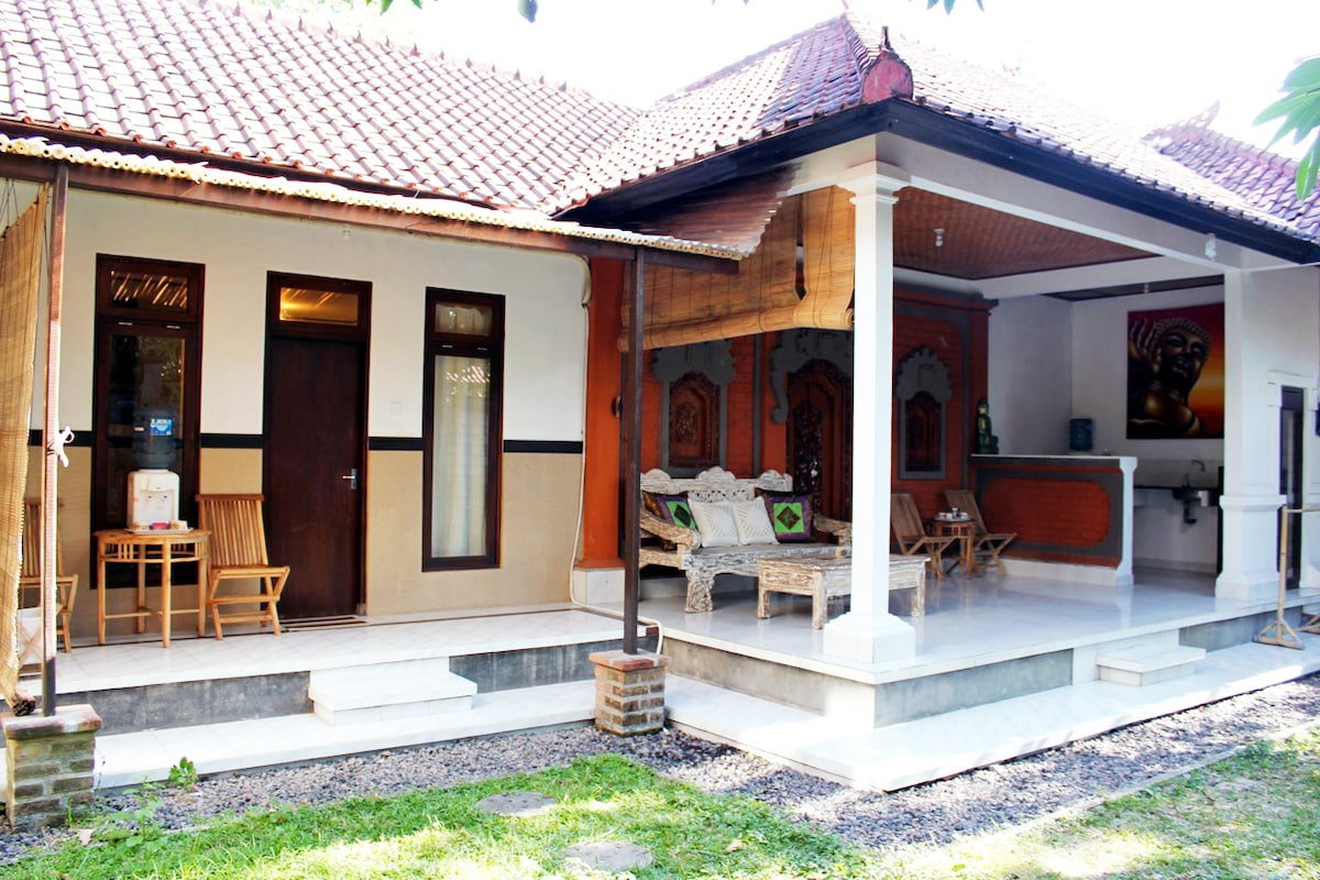 Two Bedroom Two Bathroom Villa with Beautiful Large Sofa in front and Kitchen. All Amenities.