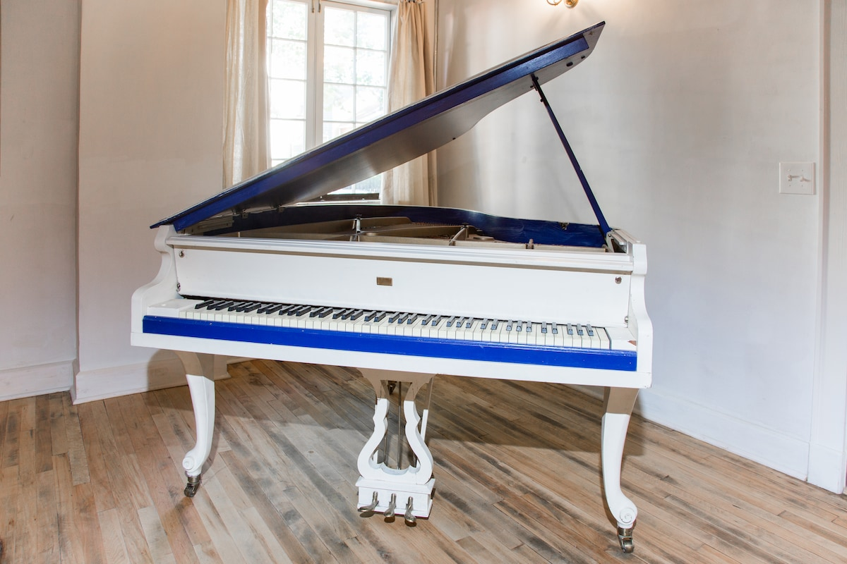 """Feel free to """"tickle the ivories"""" on the piano in the living room."""