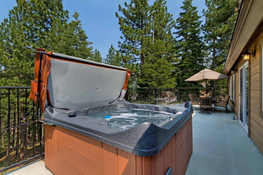 Brand new private hot tub seats 5 on the deck backing the forest